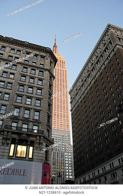 Sunlit Empire State  Building in the early evening. Midtown West Manhattan, New York, New York. USA
