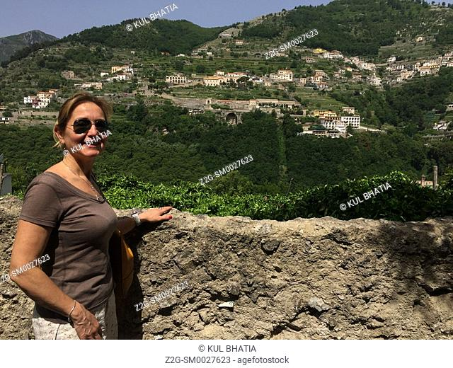 A smiling female resident of Ravello on the Amalfi Coast. Scala is in the background