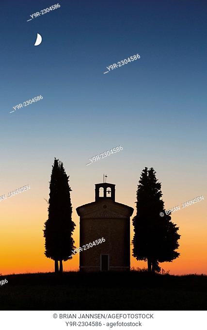 Twilight over the tiny Cappella di Vitaleta near San Quirico d'Orcia, Tuscany, Italy
