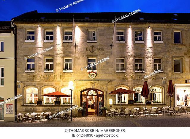 Hotel and restaurant Goldener Anker at dusk, Bayreuth, Upper Franconia, Bavaria, Germany