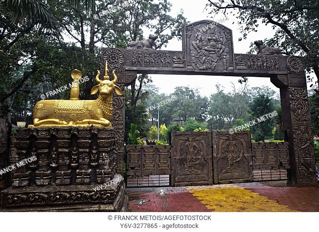 Entrance of a public park at Bhoramdeo ( Chhattisgarh state, India). The golden sculpture is representing the bull Nandi, the mount of the hindu god Shiva