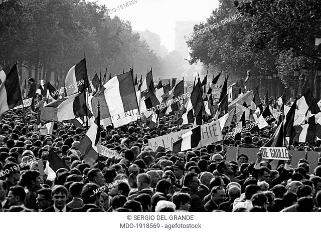 A huge crowd parading along the Champs Elysées to support the President of French Republic Charles de Gaulle during the May 1968 events in France