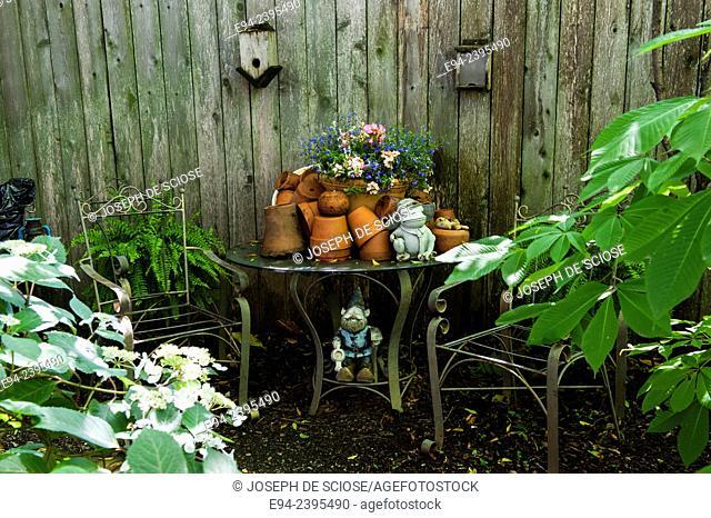 Table with terra-cotta pots in a garden setting.Georgia USA