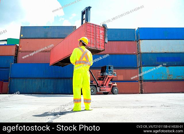 Container worker working at container cargo freight ship, Busines