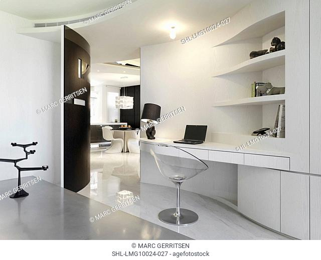 Modern style desk with bunny lamp and clear chair