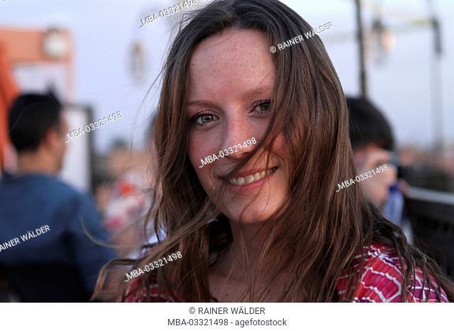 Africa, Morocco, Marrakech, Medina, Jemaa el Fna, woman in the Souk, smile, facing camera, portrait