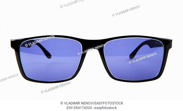 Close-Up Of Black Sunglasses Against White Background