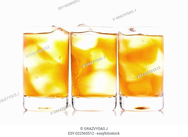 Three shot glass of drink