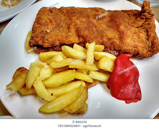 Delicious crunchy breaded steak with jam and cheese, typical from Asturias, Spain