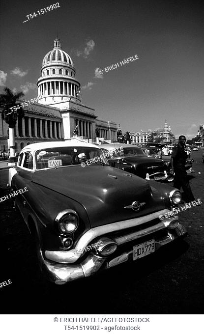 Old American Car in front of the Capitol in Havana