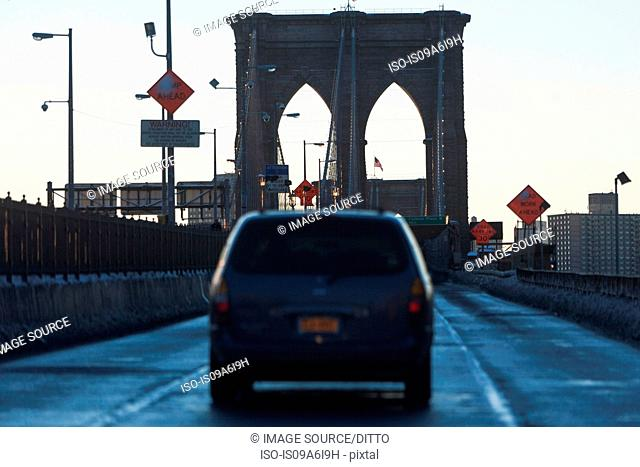 Car driving on Brooklyn Bridge