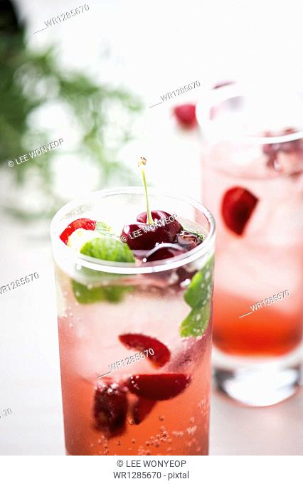 glasses of cherry juice with ice cubes