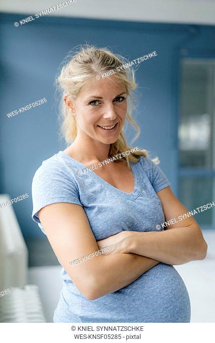 Portrait of smiling pregnant woman