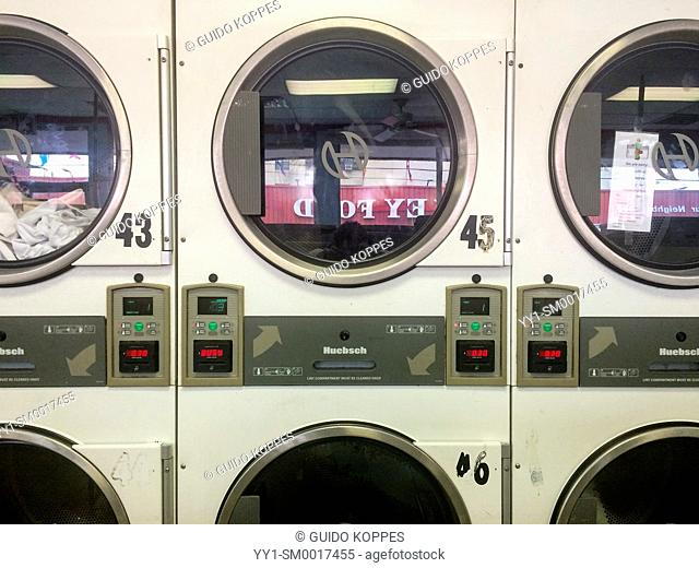 New York City, USA. Dryers at a Brooklyn based laundrette