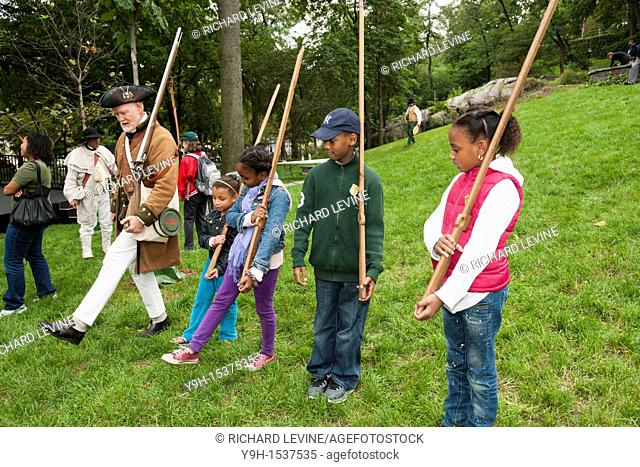 A Re-enactor teaches military procedures during the Revolutionary War to visitors at the reopening of the Hamilton Grange National Memorial at it's new home in...