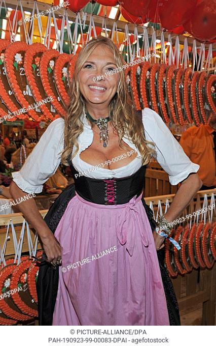 23 September 2019, Bavaria, Munich: The actress Nicole Belstler-Boettcher is a guest at the traditional Regine Sixt Damen-Wiesn in the Schützen-Festzelt at the...