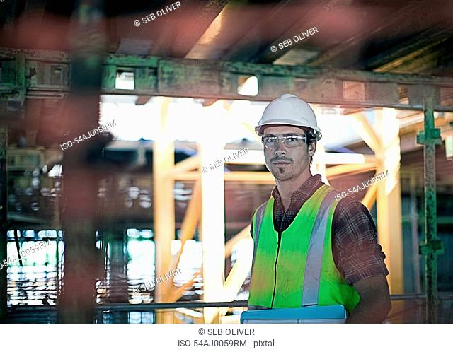 Construction worker walking on site