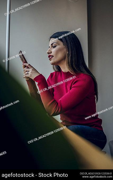 Brunette woman checking her mobile phone