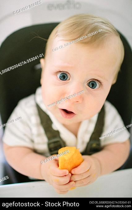 Baby making a funny expression as he tries a new food