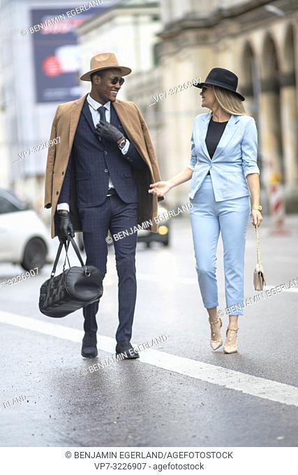 Blogger couple at street, Munich, Germany