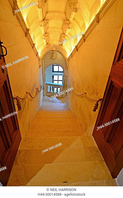Elegant stone staircase in a renaissance french chateau, with arched ceiling
