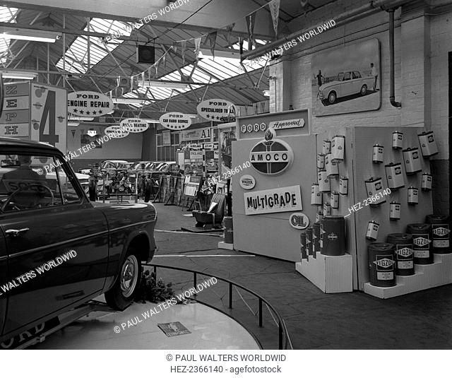 Exhibition at a Ford dealers in Rotherham, South Yorkshire, 1964. A photograph showing Amoco's range of Vigzol motor oils on a display stand on the right hand...