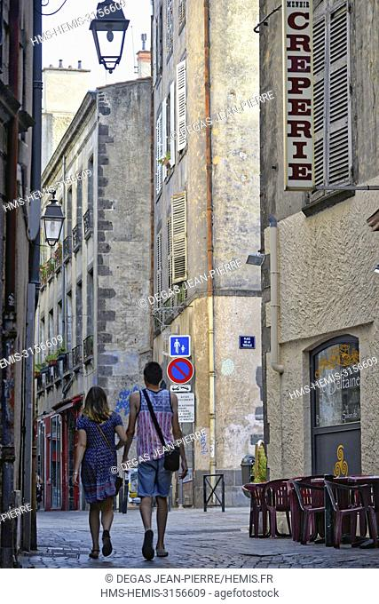 France, Puy de Dome, Clermont Ferrand, Trille Street, walkers on a pedestrian alley