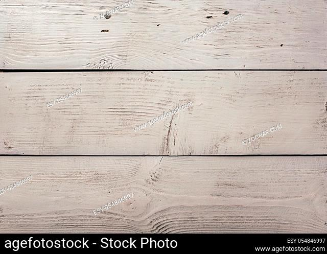 Light wood slab texture with cracks and scratches, background or wallpaper
