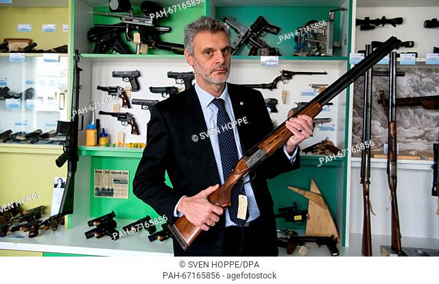 Detective Chief Superintendent Ludwig Waldinger poses with a rifle in the Weapons Museum in the State Office of Criminal Investigations (LKA) in Munich, Germany