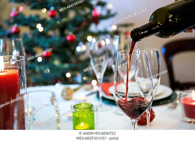 Serving wine at Christmas dinner
