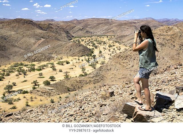 Woman overlooking Huab River in Damaraland - Huab Under Canvas, Damaraland, Namibia, Africa