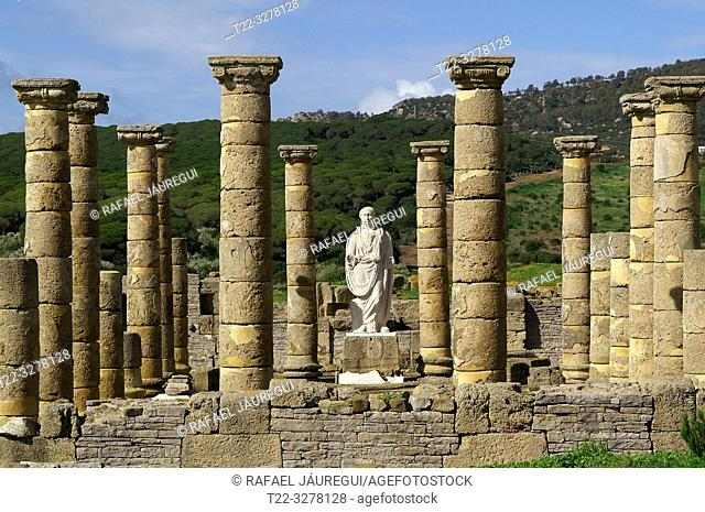 Rate (Spain). Sculpture between columns of Emperor Trajan in the Roman city of Baelo Claudia