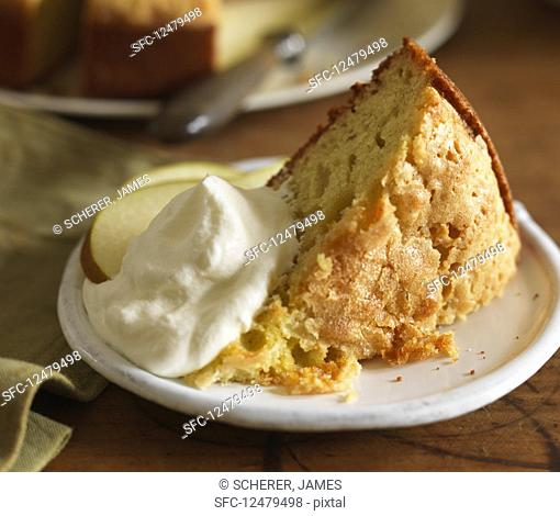 A piece of olive oil cake with cream