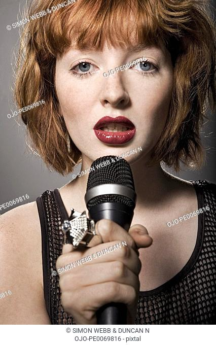 Woman holding microphone