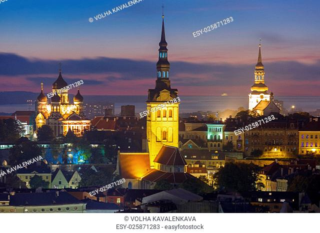 Night aerial cityscape with City Hall, St. Olaf Baptist Church and Alexander Nevsky Cathedral in Tallinn, Estonia