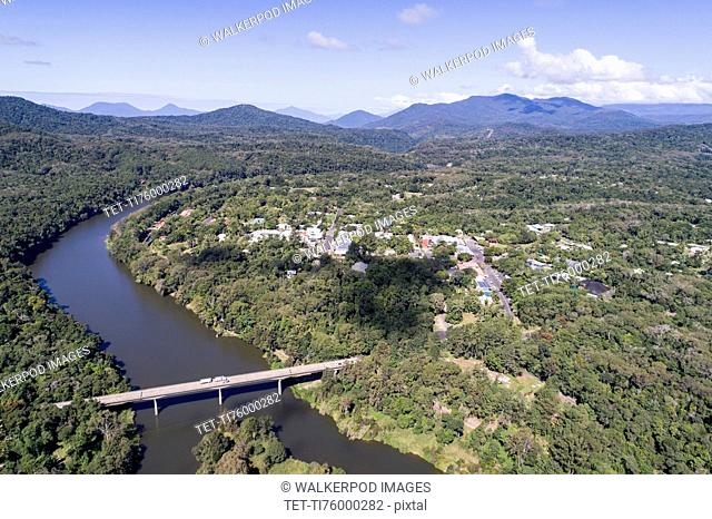 Australia, Queensland, Landscape with bridge and mountain range in background