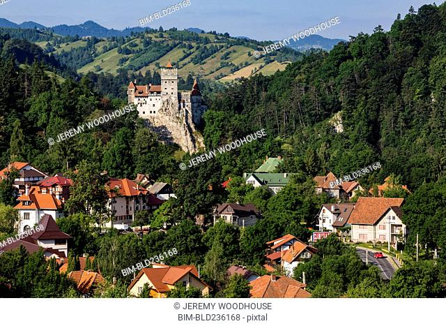 Houses and castle in valley, Bran, Transylvania, Romania