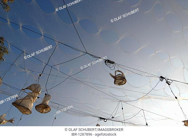 Installation made of Christmas tree netting, power cables and light objects against a blue summer sky, Radebeul Wine Festival, Altkoetschenbroda, Saxony