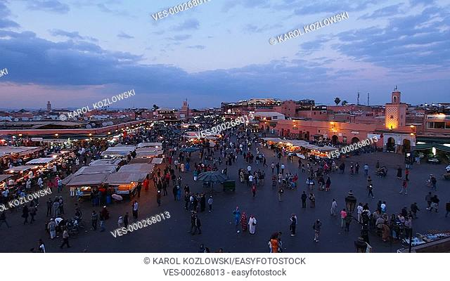Jemaa el Fna Square during the sunset on May 03, 2013 in a Marrakesh, Morocco. The square is declared UNESCO World Heritage Site