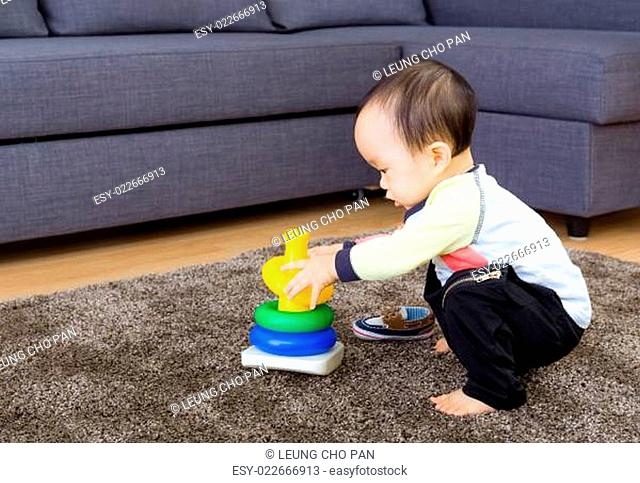 Asian baby playing pyramid build