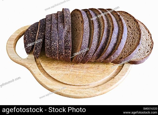 Sliced loaf of rye bread on a cutting board isolated on white