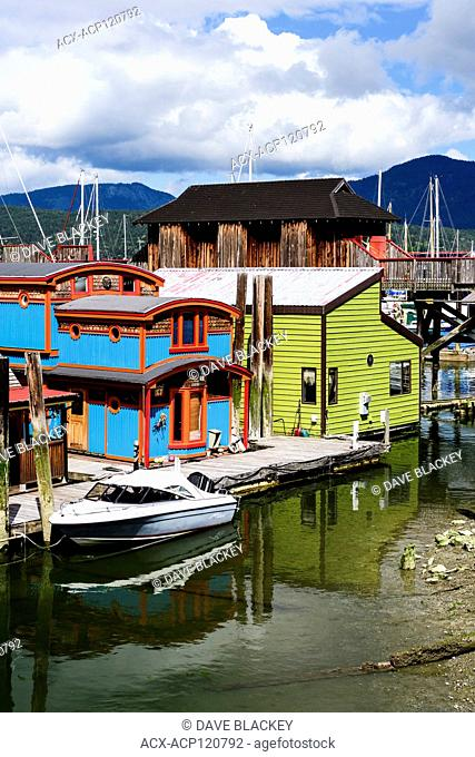 A boat and houseboats in Cowichan Bay, British Columbia