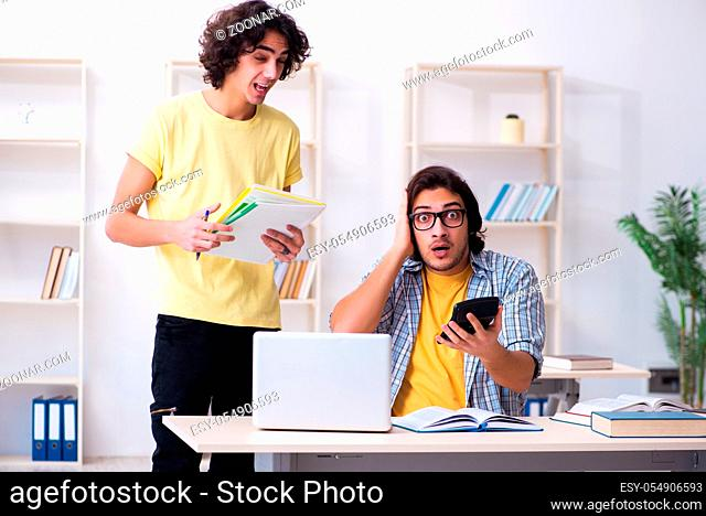 Two male students in the classroom