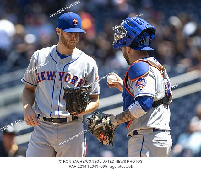 New York Mets catcher Tomas Nido (3), right, meets with starting pitcher Zack Wheeler (45), left, during the first inning against the Washington Nationals at...