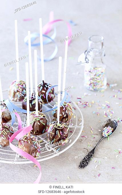 Chocolate cake pops decorated with sprinkles