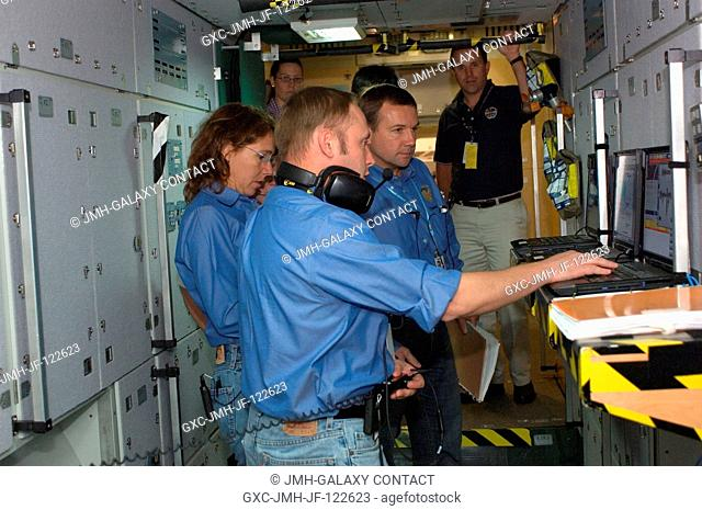 Expedition 18 crewmembers participate in a space station emergency scenarios training session in the Space Vehicle Mockup Facility at NASA's Johnson Space...