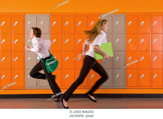 Students rushing past school lockers