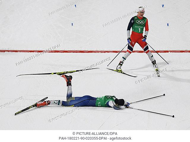 Stina Nilsson (front) from Sweden lying on the ground at the finish line while Maiken Caspersen Falla from Norway (back) passes by during the women's free team...