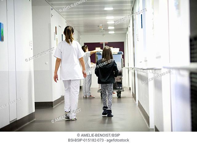 Reportage in the pediatric unit in a hospital in Haute-Savoie, France. An auxiliary nurse takes a young patient to the canteen