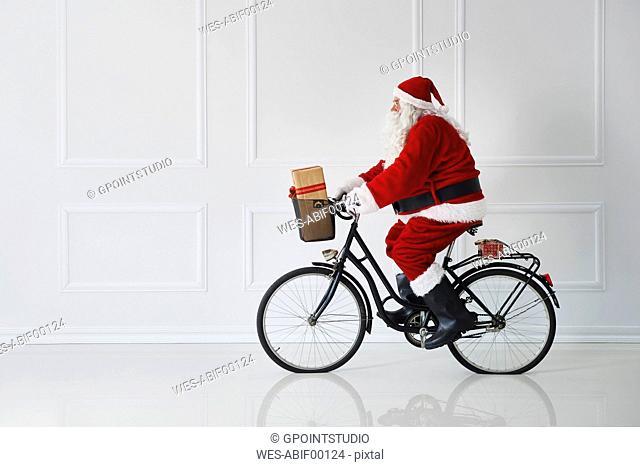 Santa Claus riding a bike